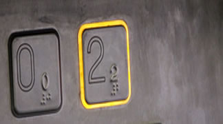 pulsadores plataforma minusválidos